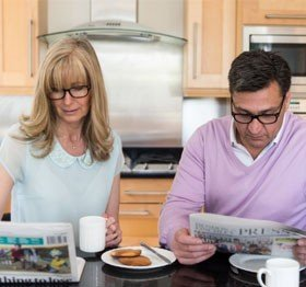 Reading the morning newspaper with UV Reader reading glasses